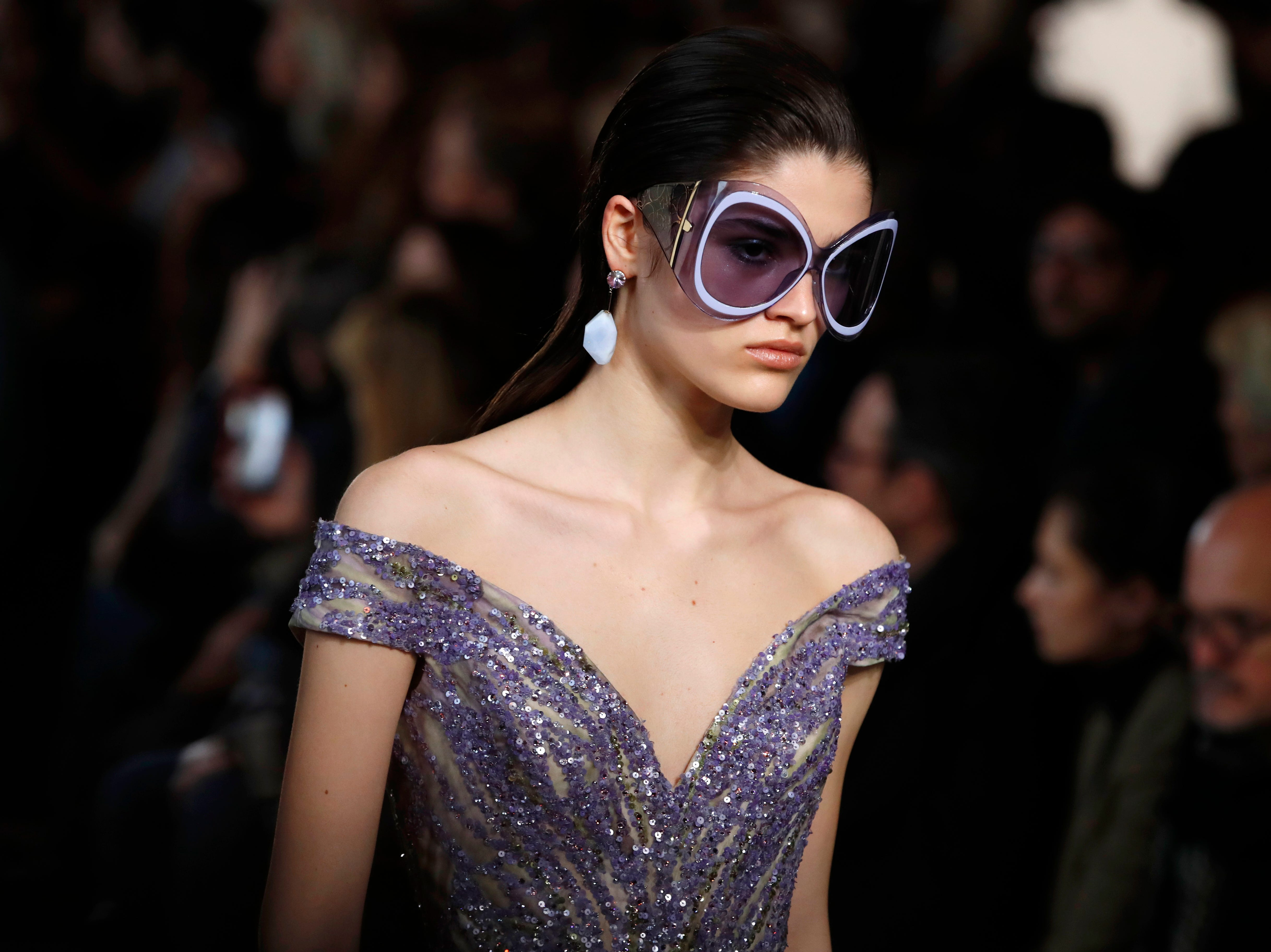 A model wears a creation for the Elie Saab Spring/Summer 2019 Haute Couture fashion collection presented in Paris, Wednesday Jan. 23, 2019. (AP Photo/Christophe Ena) ORG XMIT: LENT109