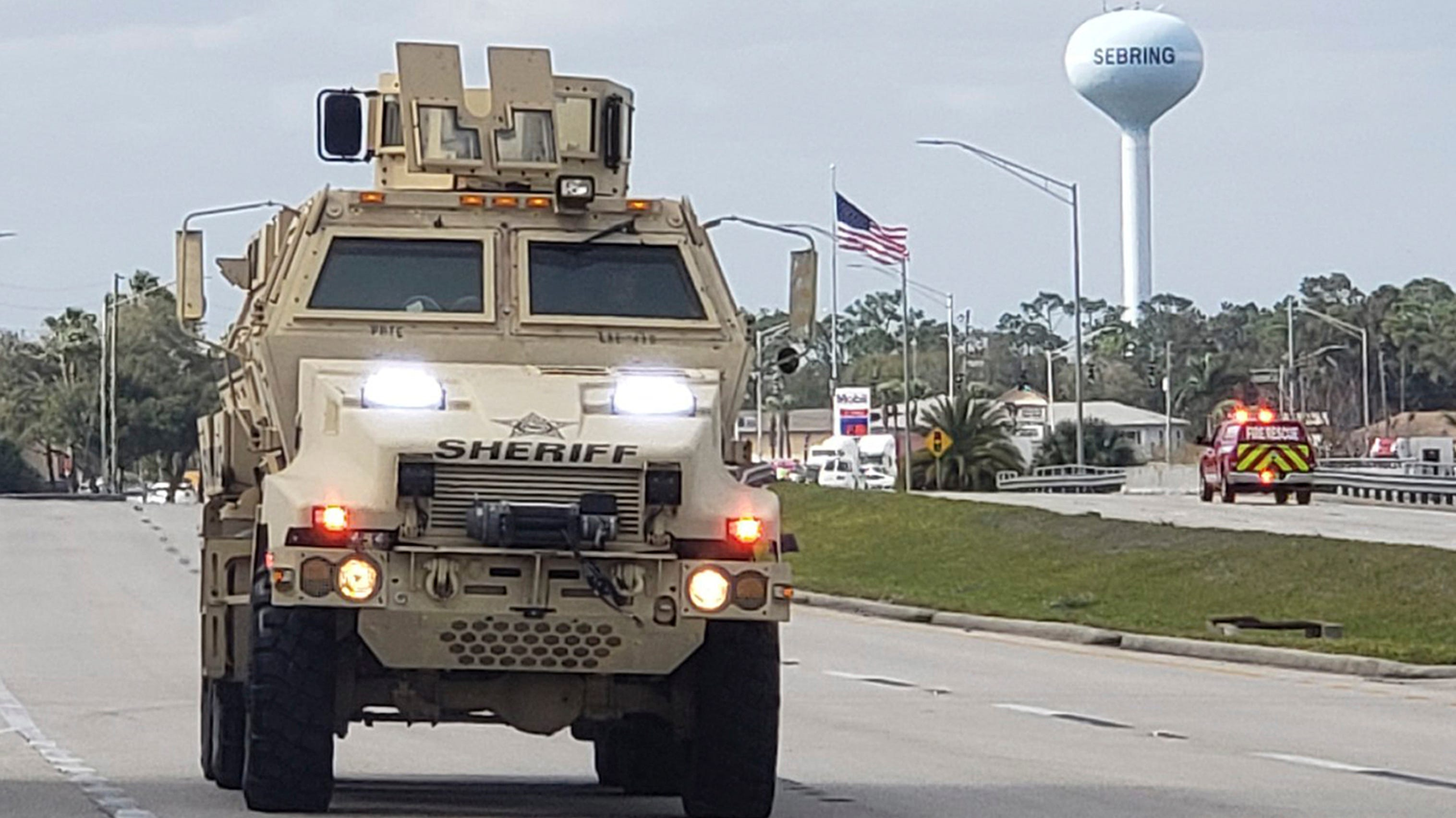 A sheriff's department armored vehicle arrives at...