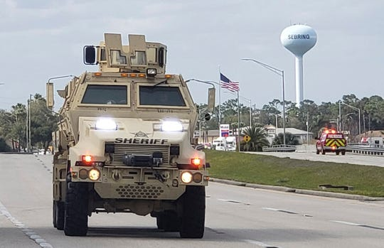 A sheriff's department armored vehicle arrives at a SunTrust Bank branch on Jan. 23, 2019, in Sebring, Fla.