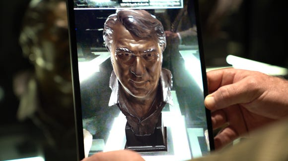 The interactive digital replica of John Madden's Hall of Fame bronze bust.
