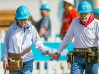 Former President Jimmy Carter holds hands with his wife, Rosalynn, as they work with other volunteers during the first day of the weeklong Jimmy & Rosalynn Carter Work Project, their 35th work project with Habitat for Humanity, on Aug. 27, 2018, in Mishawaka, Ind.