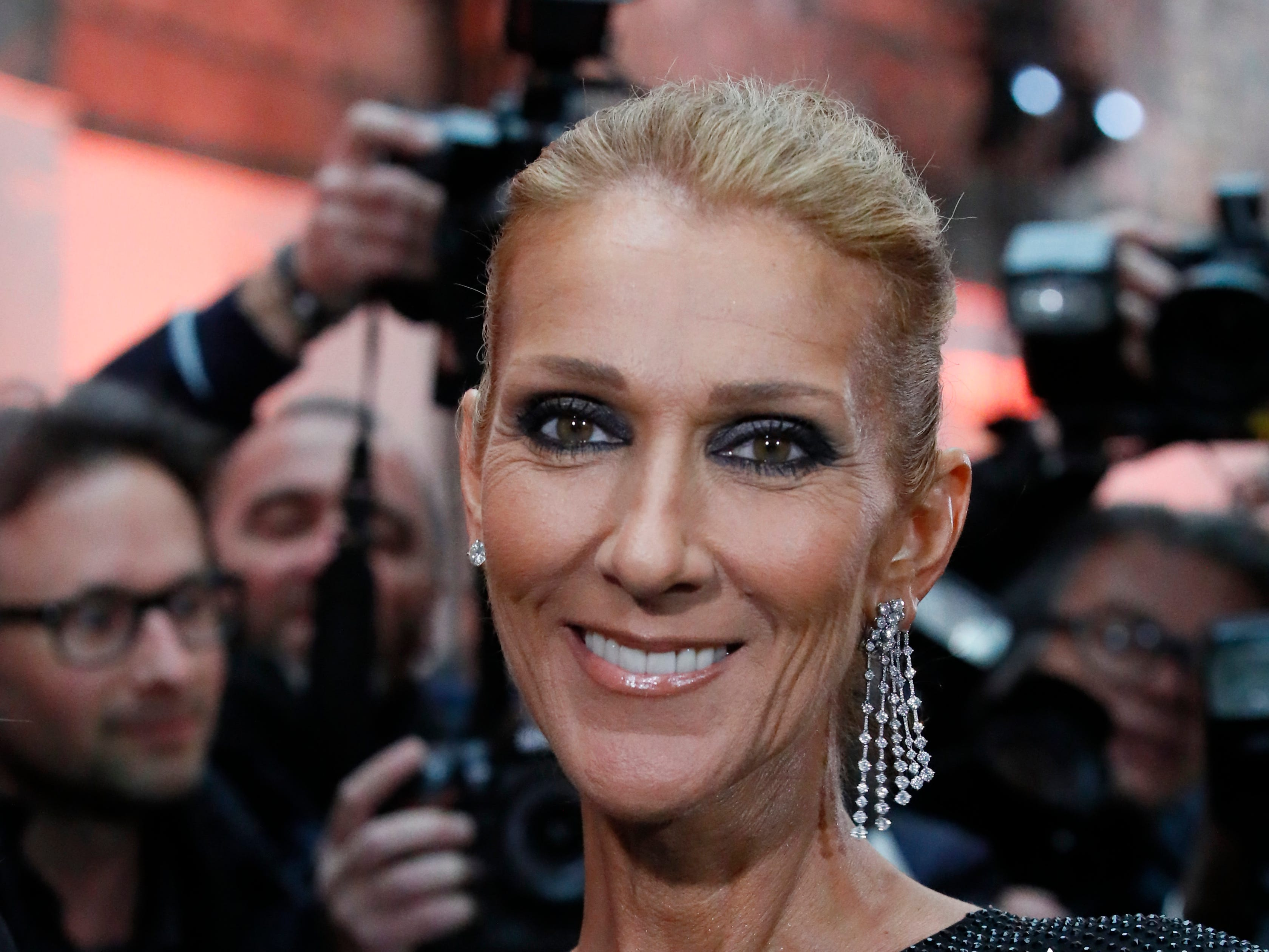 Singer Celine Dion arrives for the Vauthier Spring/Summer 2019 Haute Couture fashion collection presented in Paris, Tuesday Jan. 22, 2019. (AP Photo/Francois Mori) ORG XMIT: LENT153