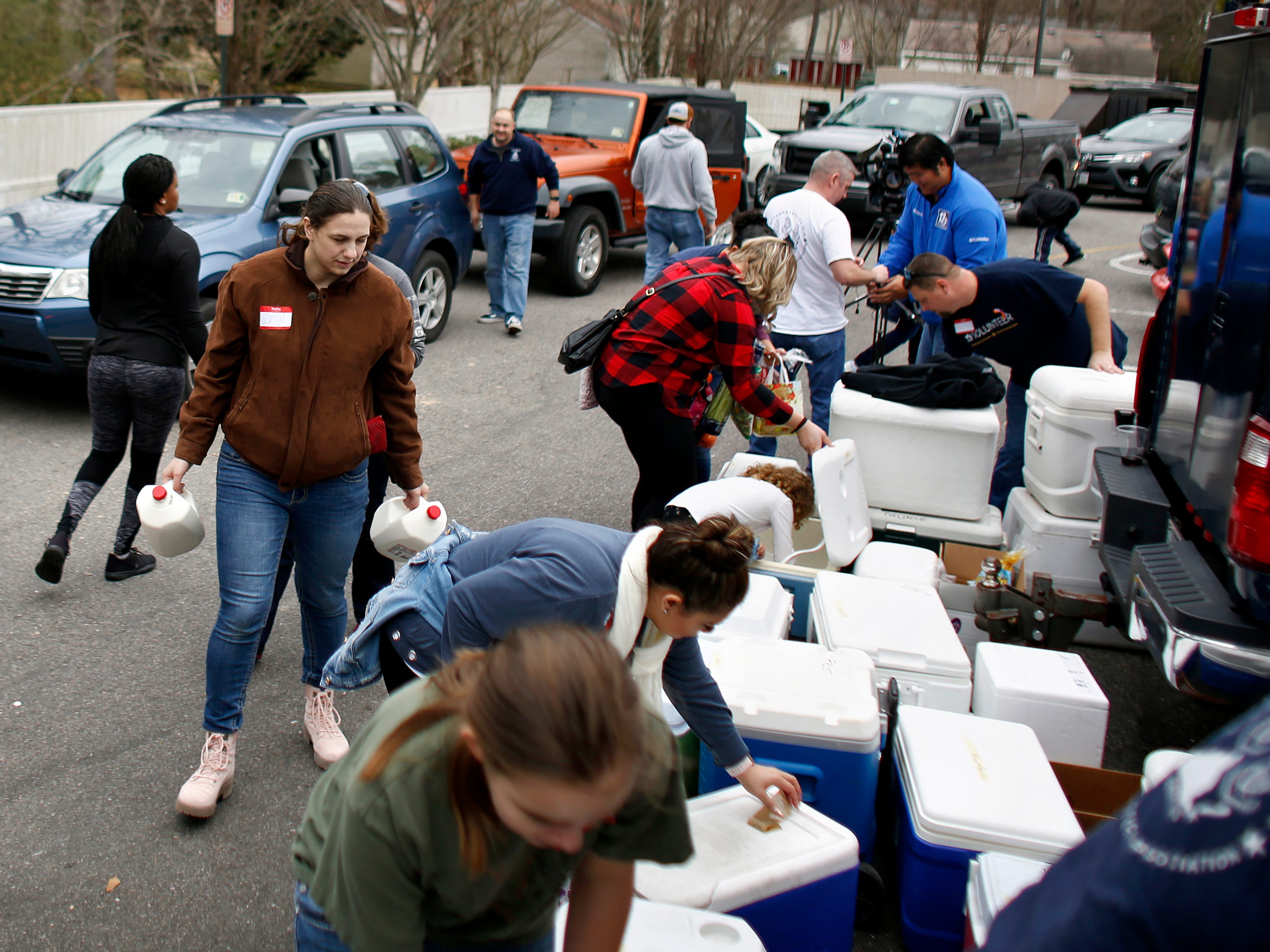 Hundreds of volunteers and recipients Saturday, Jan. 19, 2019 at Help for Hampton Roads Coast Guard Families food drive, sponsored by the Chief Petty Officer Association, in Chesapeake for families affected by the shutdown. (Stephen M. Katz/The Virginian-Pilot via AP) ORG XMIT: VANOV105