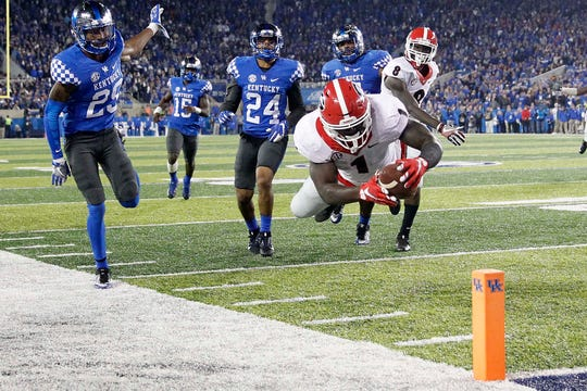 Patriots RB Sony Michel going airborne during his Georgia Bulldogs days.