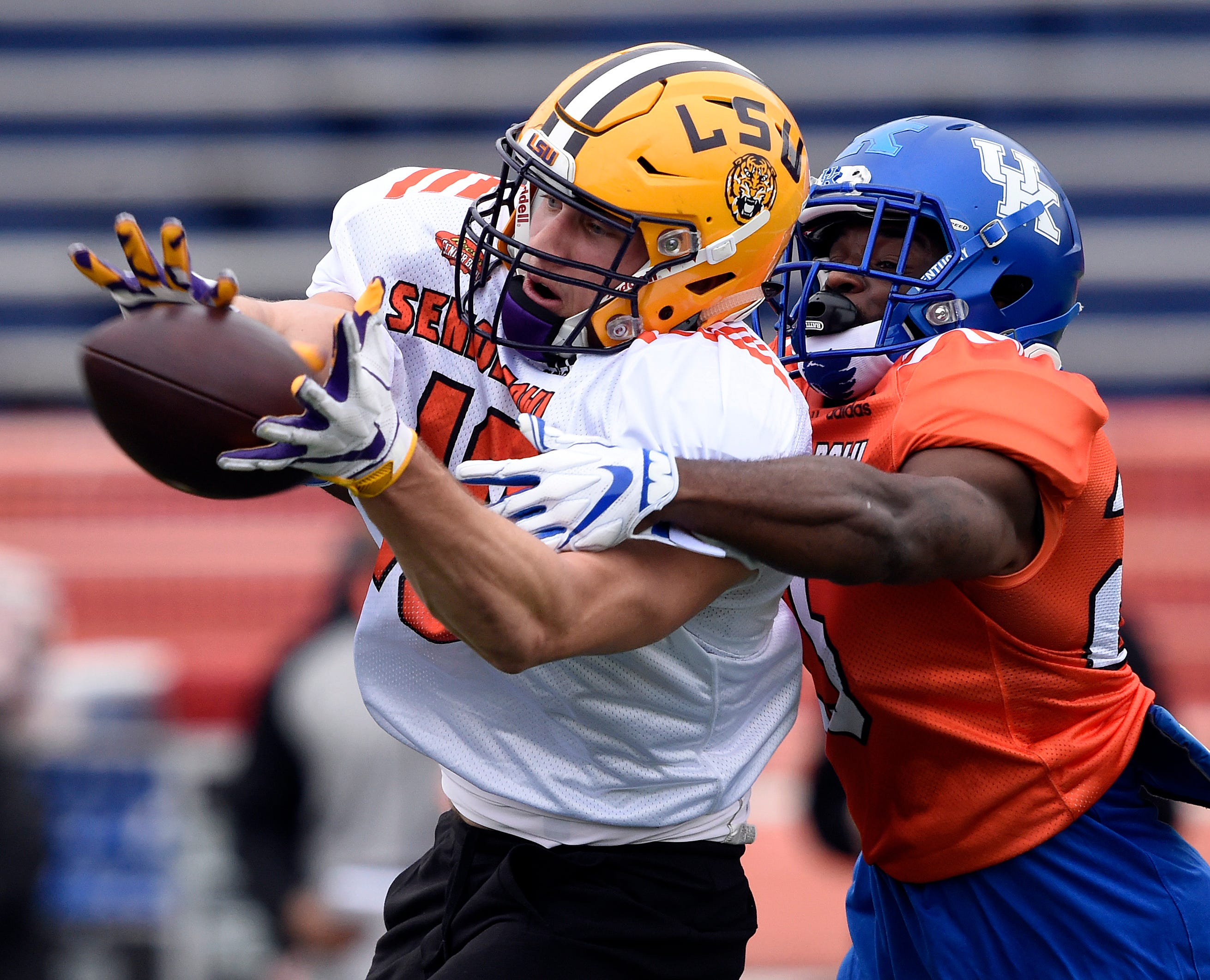 South tight end Foster Moreau of SU pulls in a pass over South safety Darius West of Kentucky during the South squad Senior Bowl practice at Ladd-Peebles Stadium.