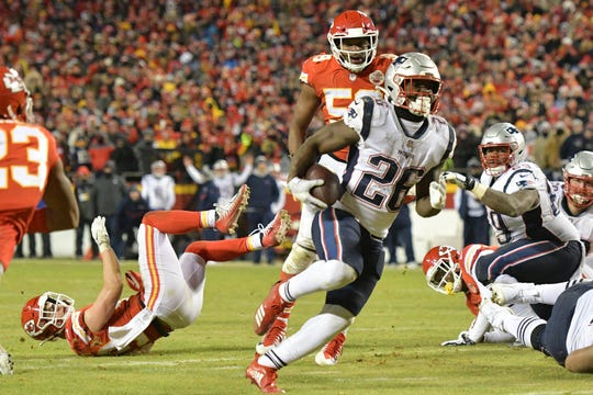 New England  running back Sony Michel (26) scores during the second half of the AFC Championship game against  Kansas City.
