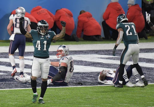 Philadelphia Eagles cornerback Ronald Darby (41) celebrates after breaking up a hail mary pass to the New England Patriots in the fourth quarter in Super Bowl LII at U.S. Bank Stadium.