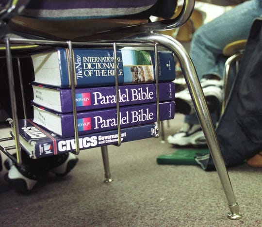 Textbooks rest under the seats of Angell Caudill's Biblical History class at Reynolds High School in Winston-Salem, N.C., on Oct. 23, 1997.