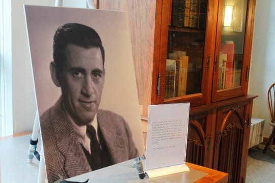 """A previously unseen photo of author J.D. Salinger is displayed at the University of New Hampshire in Durham, N.H., on Tuesday, Jan. 22, 2019. The photos taken for the book jacket of Salinger's 1951 novel, """"Catcher in the Rye,"""" were among nearly 50,000 images bequeathed to the university by German photographer Lotte Jacobi. (AP Photo/Holly Ramer) ORG XMIT: NHHR201"""