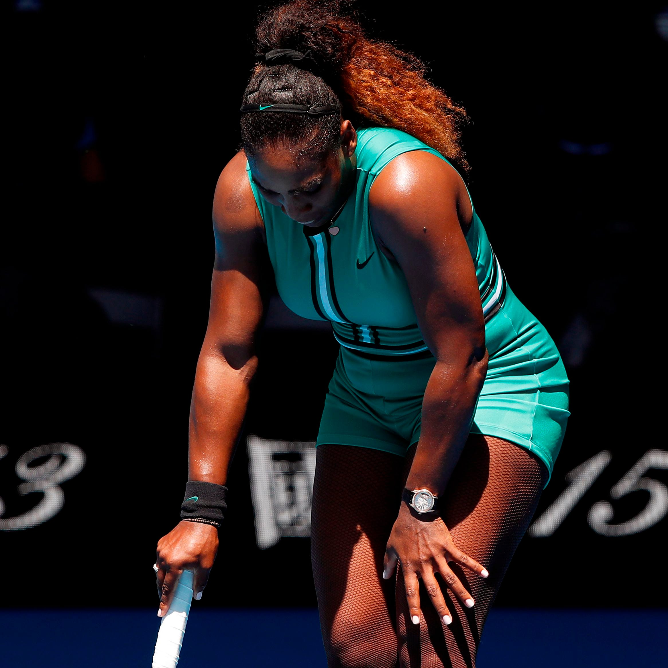 Serena Williams reacts during her match against...