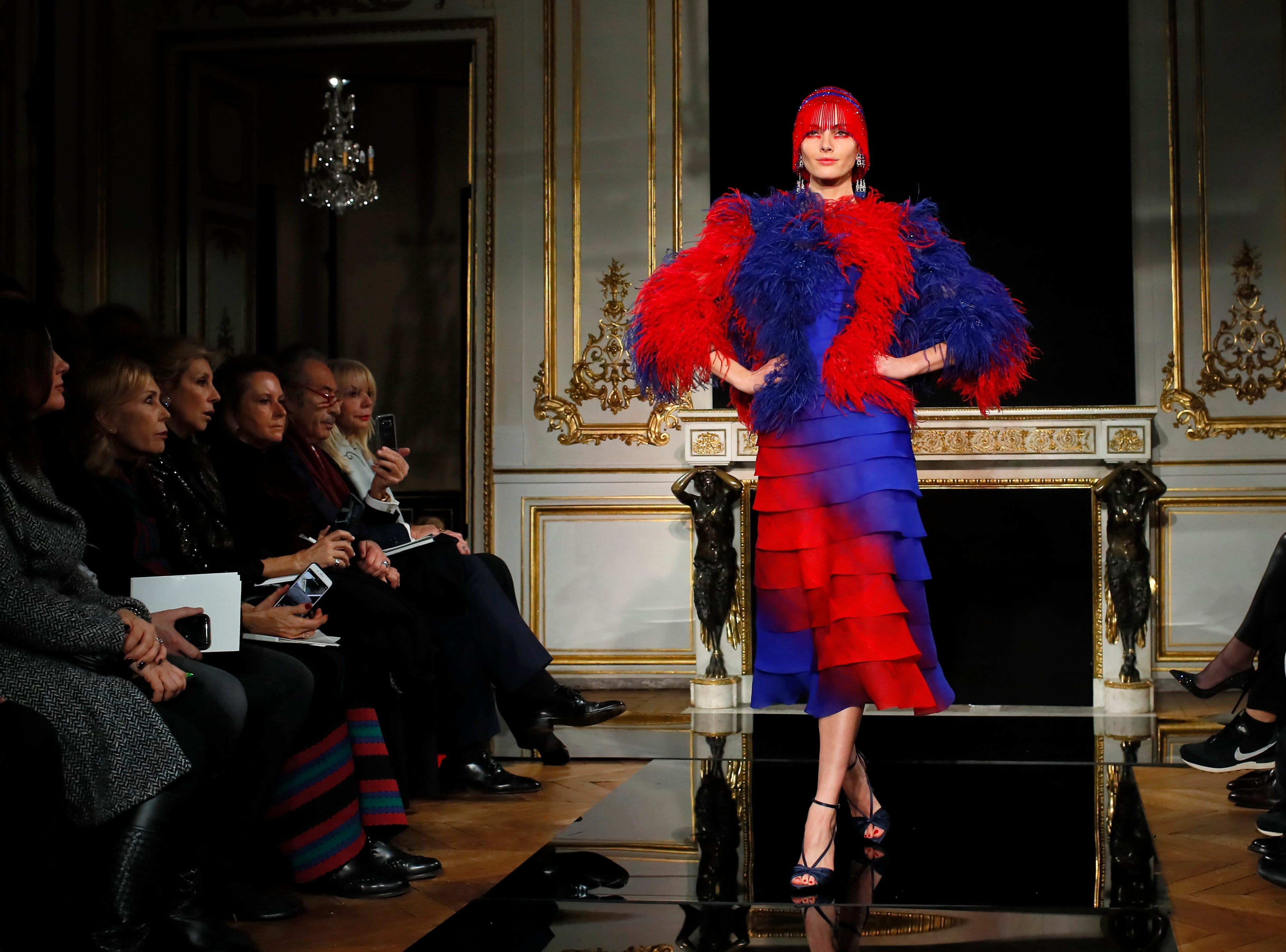 A model wears a creation for the Armani Spring/Summer 2019 Haute Couture fashion collection presented in Paris, Tuesday Jan. 22, 2019. (AP Photo/Francois Mori) ORG XMIT: LENT182