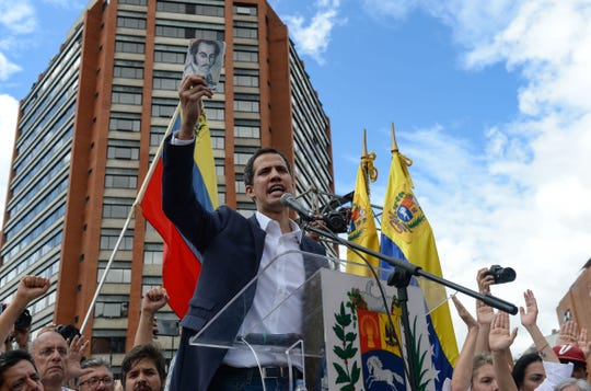"Venezuela's National Assembly head Juan Guaido speaks to the crowd during a mass opposition rally against leader Nicolas Maduro in which he declared himself the country's ""acting president"", on the anniversary of a 1958 uprising that overthrew military dictatorship, in Caracas on January 23, 2019."