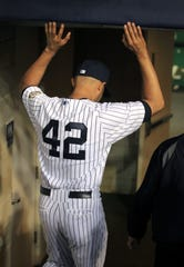 Mariano Rivera played his entire career with the New York Yankees, honoring Jackie Robinson by wearing No. 42.