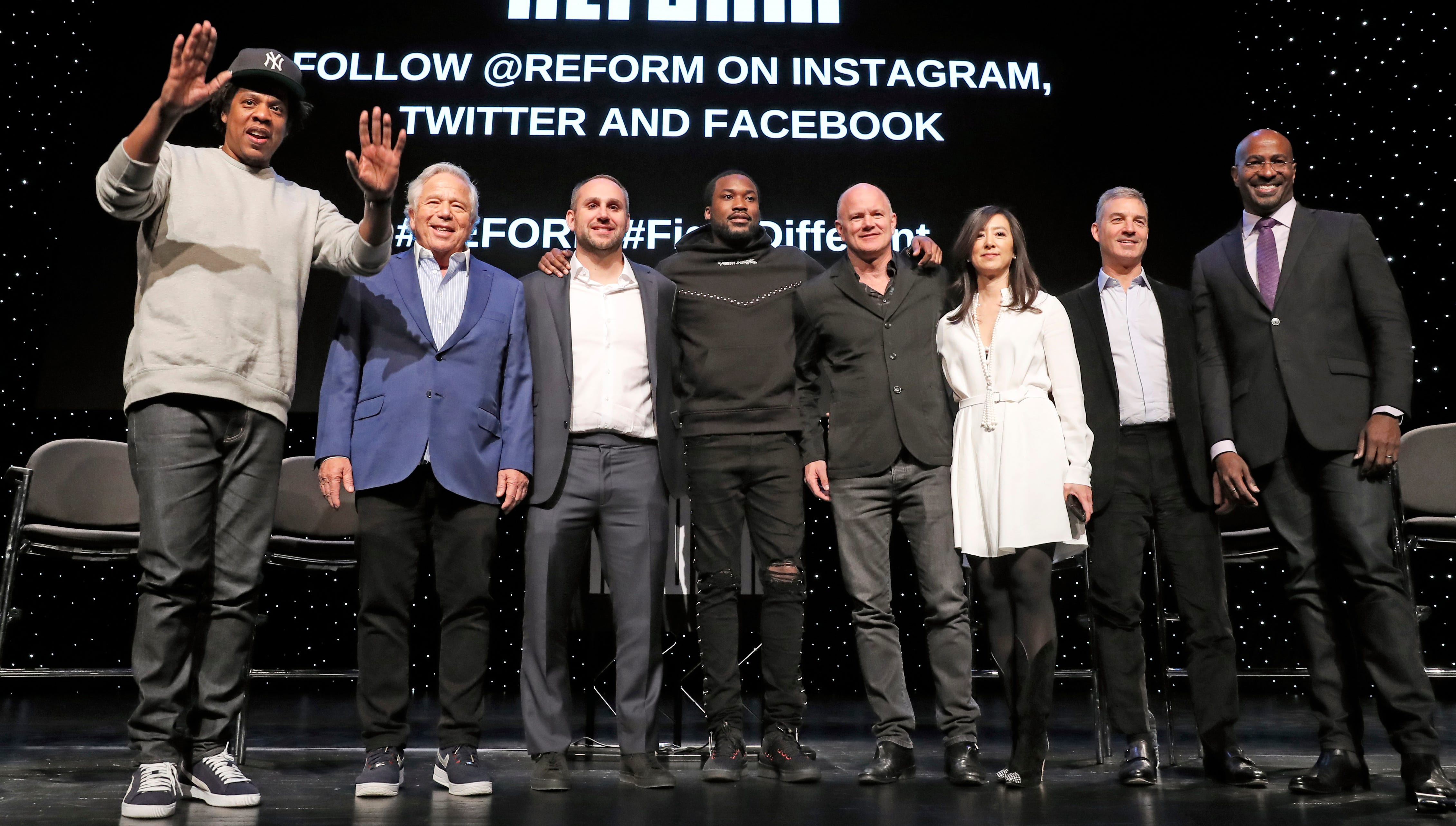 """Entrepreneur ad recording artist Shawn """"Jay-Z"""" Carter, from left, gestures as he poses with New England Patriots owner Robert Kraft, Philadelphia 76ers co-owner and Fanatics executive chairman Michael Rubin, recording artist Meek Mill, Galaxy Digital CEO and founder Michael Novogratz, Brooklyn Nets co-owner Clara Wu Tsai, Third Point CEO and founder Daniel S. Loeb, and REFORM Alliance CEO and political activist Van Jones after the group announced a partnership to transform the American criminal justice system, Wednesday, Jan. 23, 2019, in New York."""