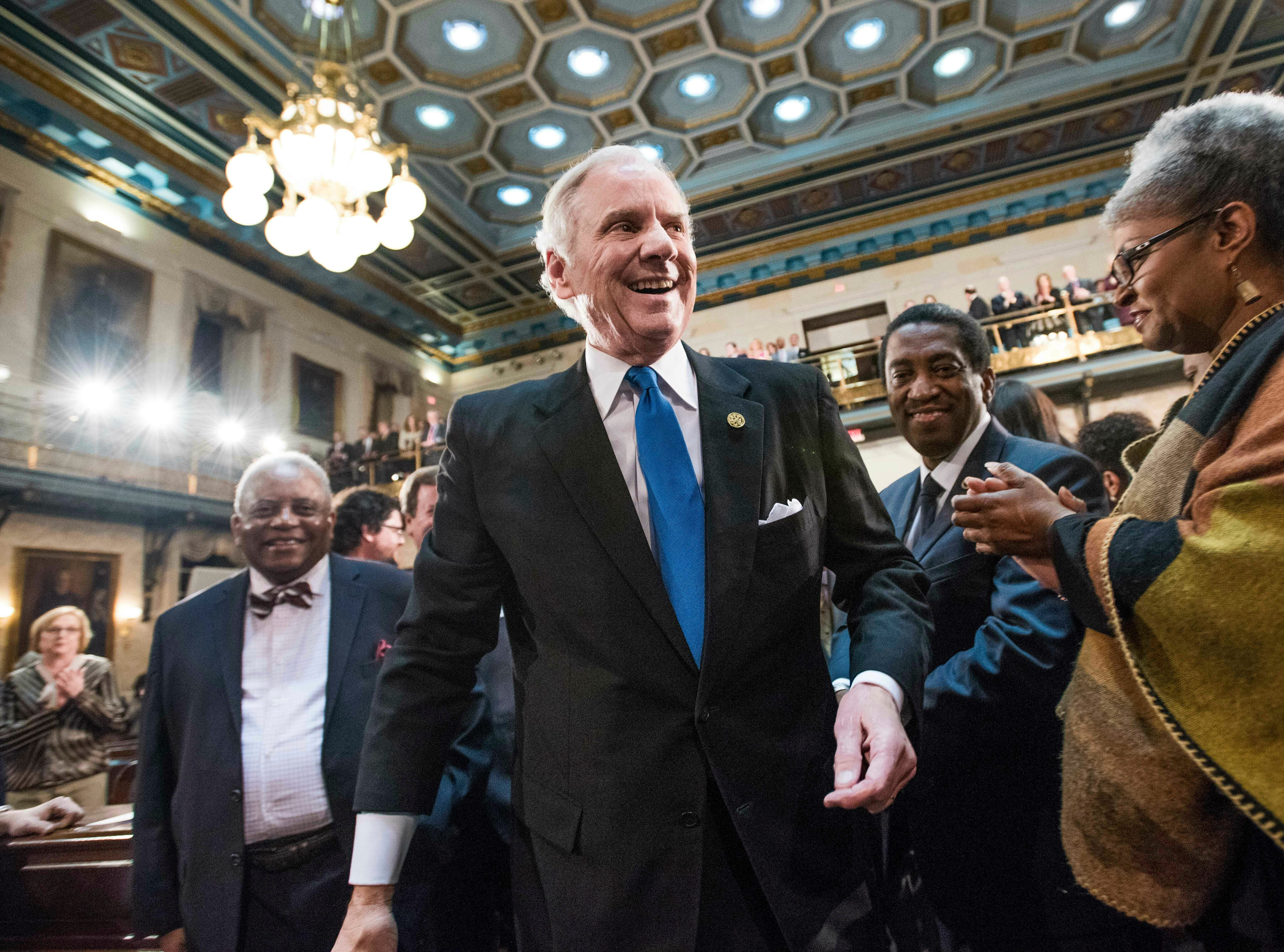 South Carolina Governor Henry McMaster greets lawmakers, including Rep. Wendy Brawley, D-Richland, right, before delivering the State of the State address at the South Carolina Statehouse, Wednesday, Jan. 23, 2019, in Columbia, S.C. (AP Photo/Sean Rayford)