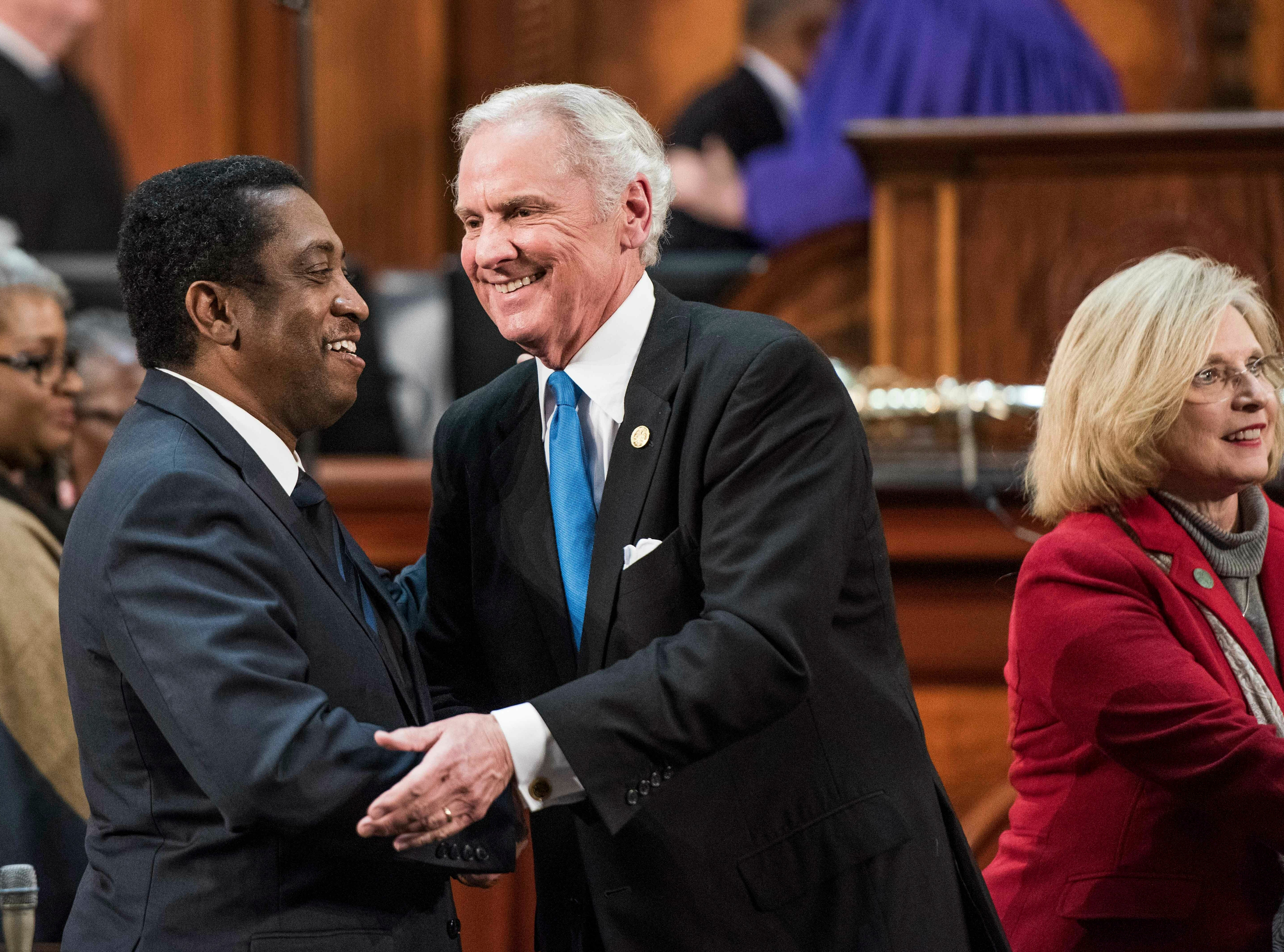 South Carolina Gov. Henry McMaster greets Rep. Jerry Govan, D-Orangeburg, left, after delivering the State of the State address at the Statehouse, Wednesday, Jan. 23, 2019, in Columbia, S.C. (AP Photo/Sean Rayford)