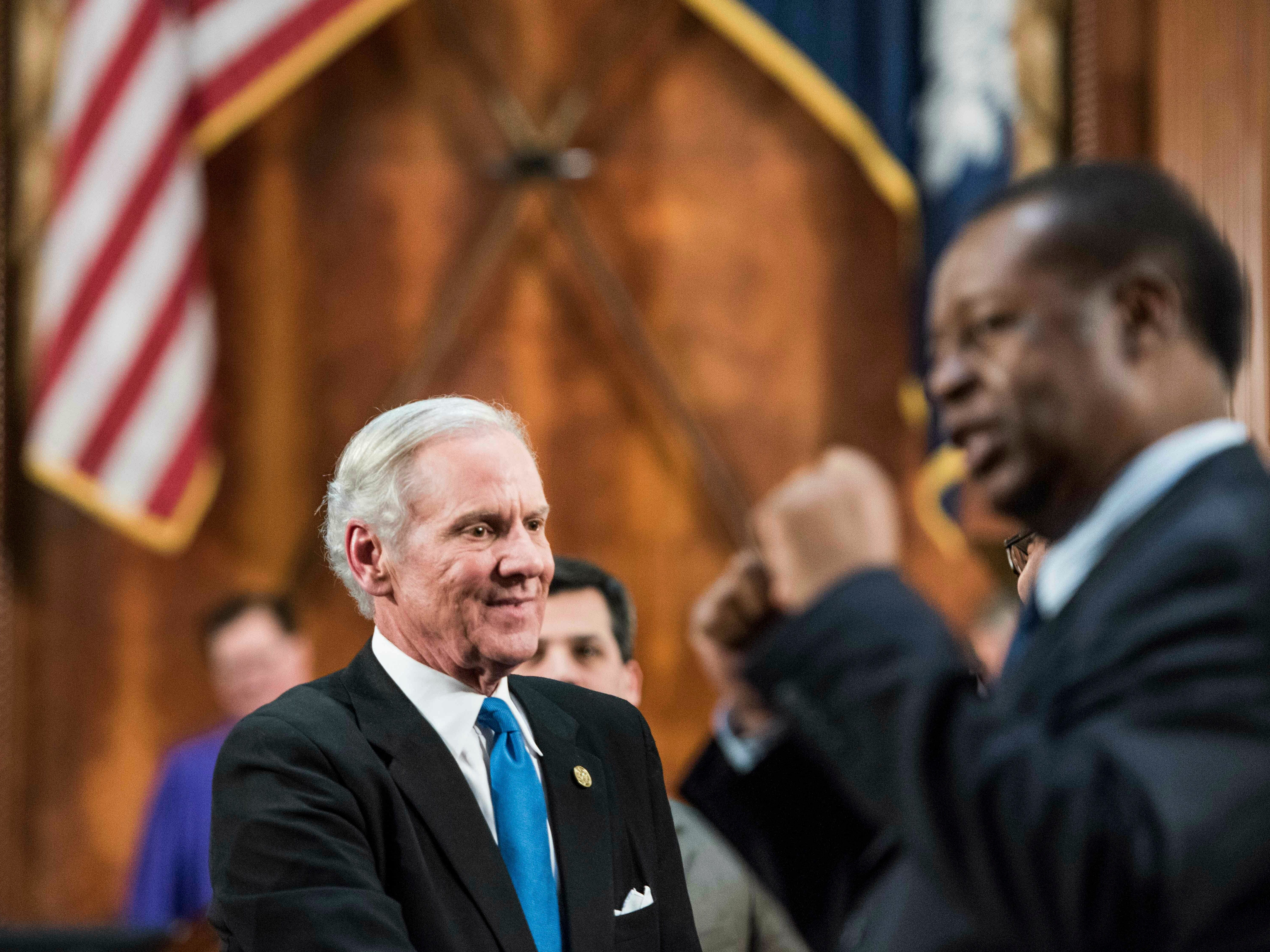 South Carolina Governor Henry McMaster greets lawmakers as Rep. Carl Anderson, D-Georgetown, right, pumps his fists after the State of the State address at the South Carolina Statehouse, Wednesday, Jan. 23, 2019, in Columbia, S.C. (AP Photo/Sean Rayford)