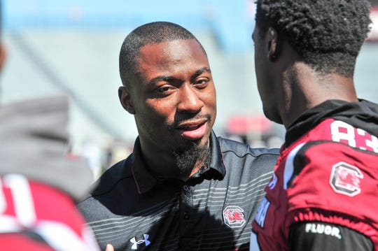 Marcus Lattimore, Director of Player Development for the University of South Carolina Football, talks with a player.
