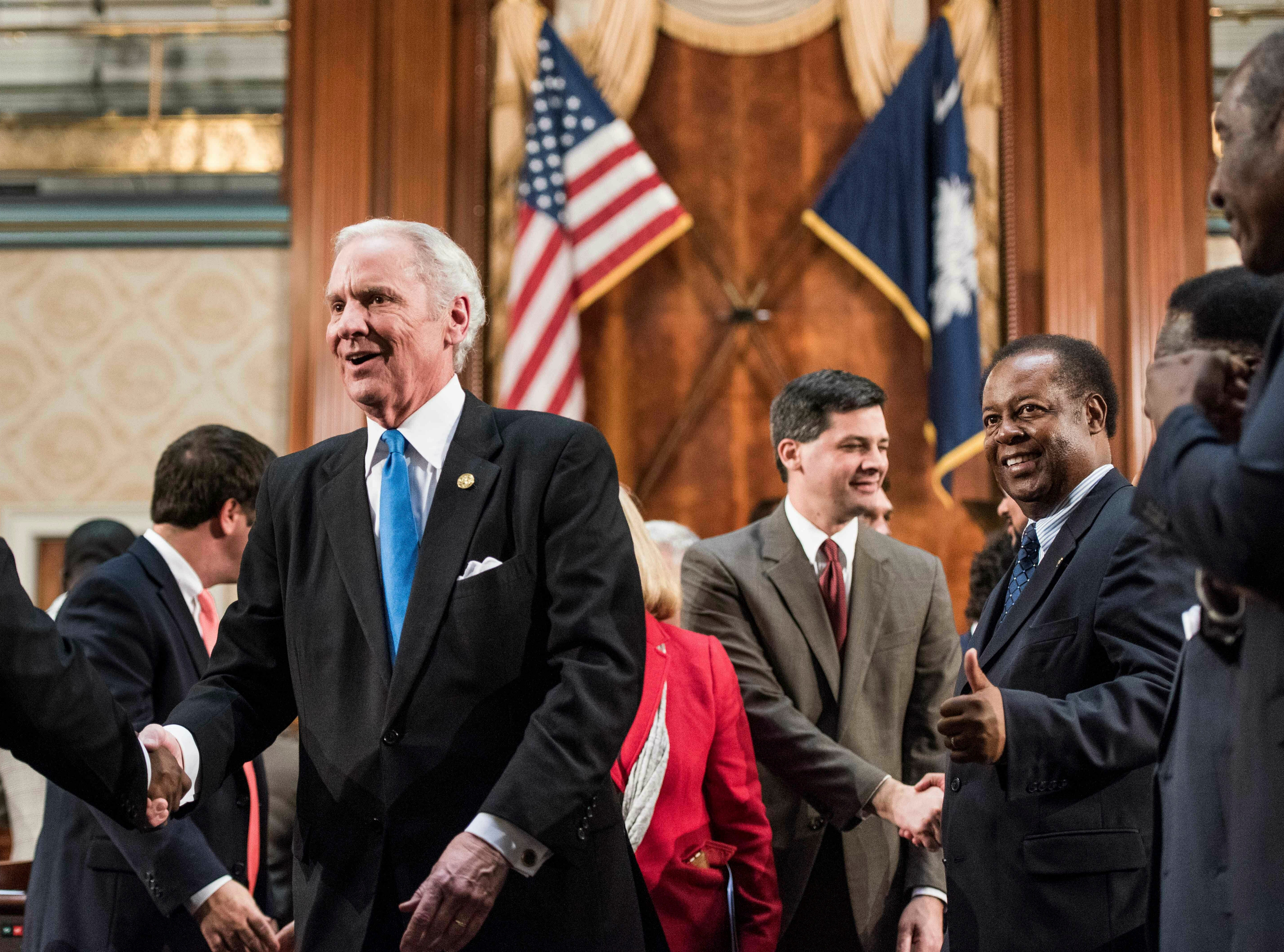 South Carolina Governor Henry McMaster greets lawmakers after delivering the State of the State address at the South Carolina Statehouse, Wednesday, Jan. 23, 2019, in Columbia, S.C. (AP Photo/Sean Rayford)