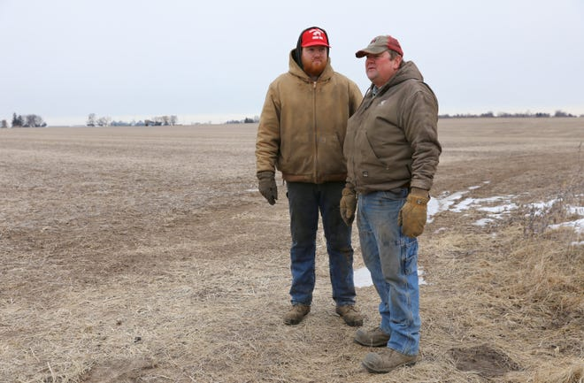 Andrew Bishop, left, and Bob Bishop stand on their family farm in Cobb. The Bishop family plans to lease about 650 acres of agricultural land for Invenergy's Badger Hollow Solar Farm. They say the income will allow their farm to stay in business.