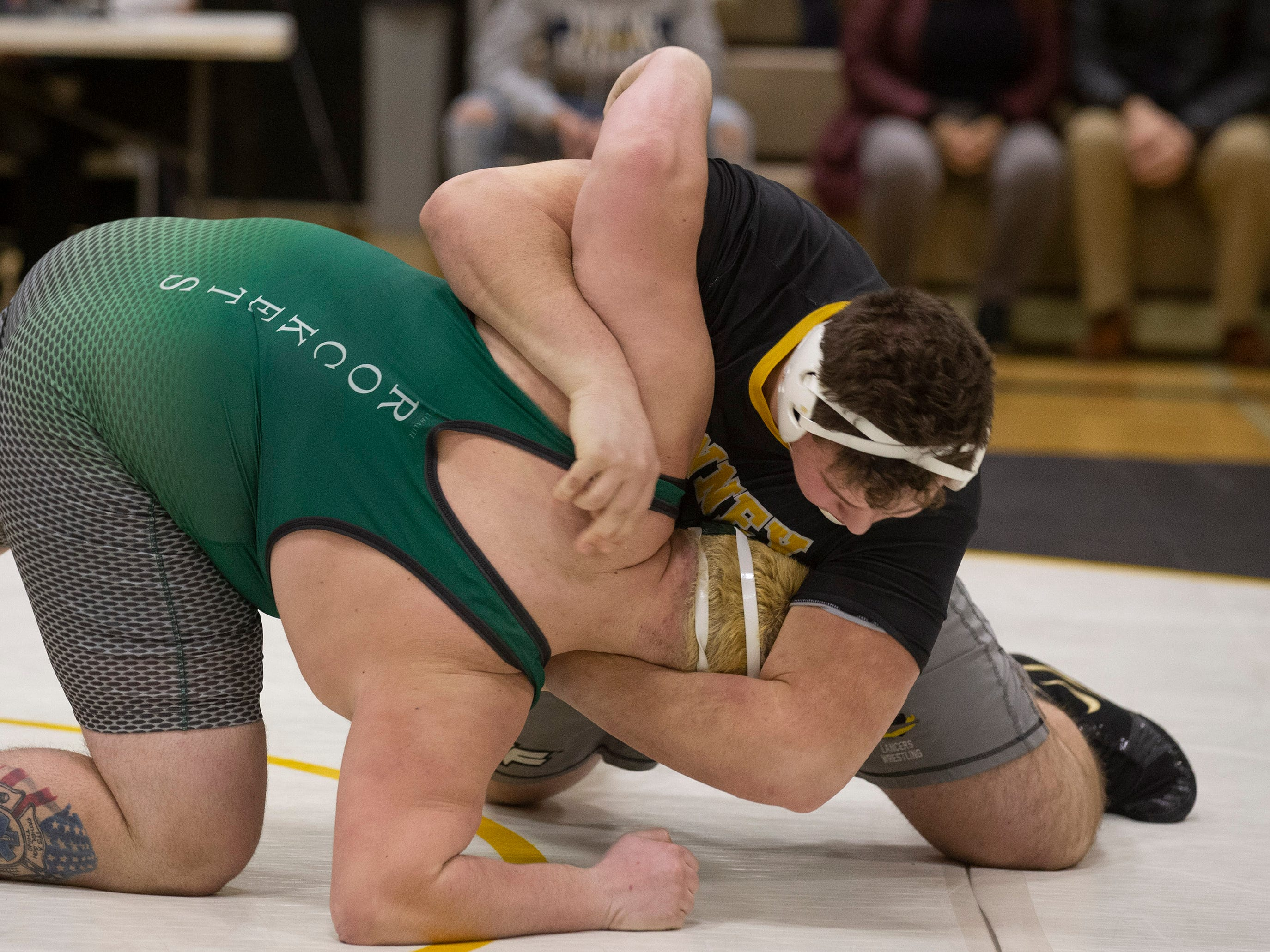 St John Vianney's Paul Liseno wins his 100th win with a quick pin of Raritan's Matt Spirko in their 285 lbs. bout. Raritan Wrestling defeats St John Vianney in Holmdel, NJ on January 23, 2019.