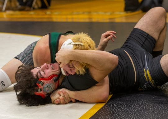 Raritan's Anthony Bailey pins St. John' Vianney's Nick Caruti in the 160-pound bout Wednesday night. Raritan won the match 45-24
