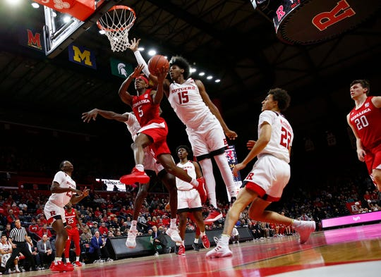 Nebraska Cornhuskers guard Glynn Watson Jr. (5) drives to the basket against Rutgers Scarlet Knights center Myles Johnson (15)