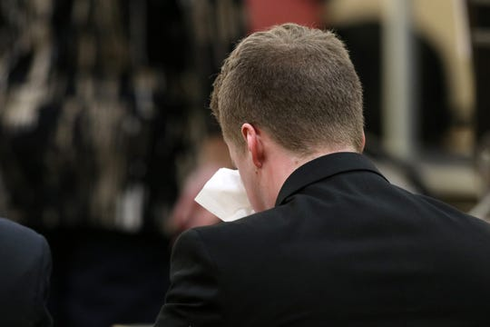 Liam McAtasney, who is charged with the murder of former high school classmate, Sarah Stern, wipes tears from his eyes as former Brennen's Steakhouse co-worker Laura Carmody testifies during the second day of trial before Superior Court Judge Richard W. English at the Monmouth County Courthouse in Freehold, NJ Thursday January 24, 2019.