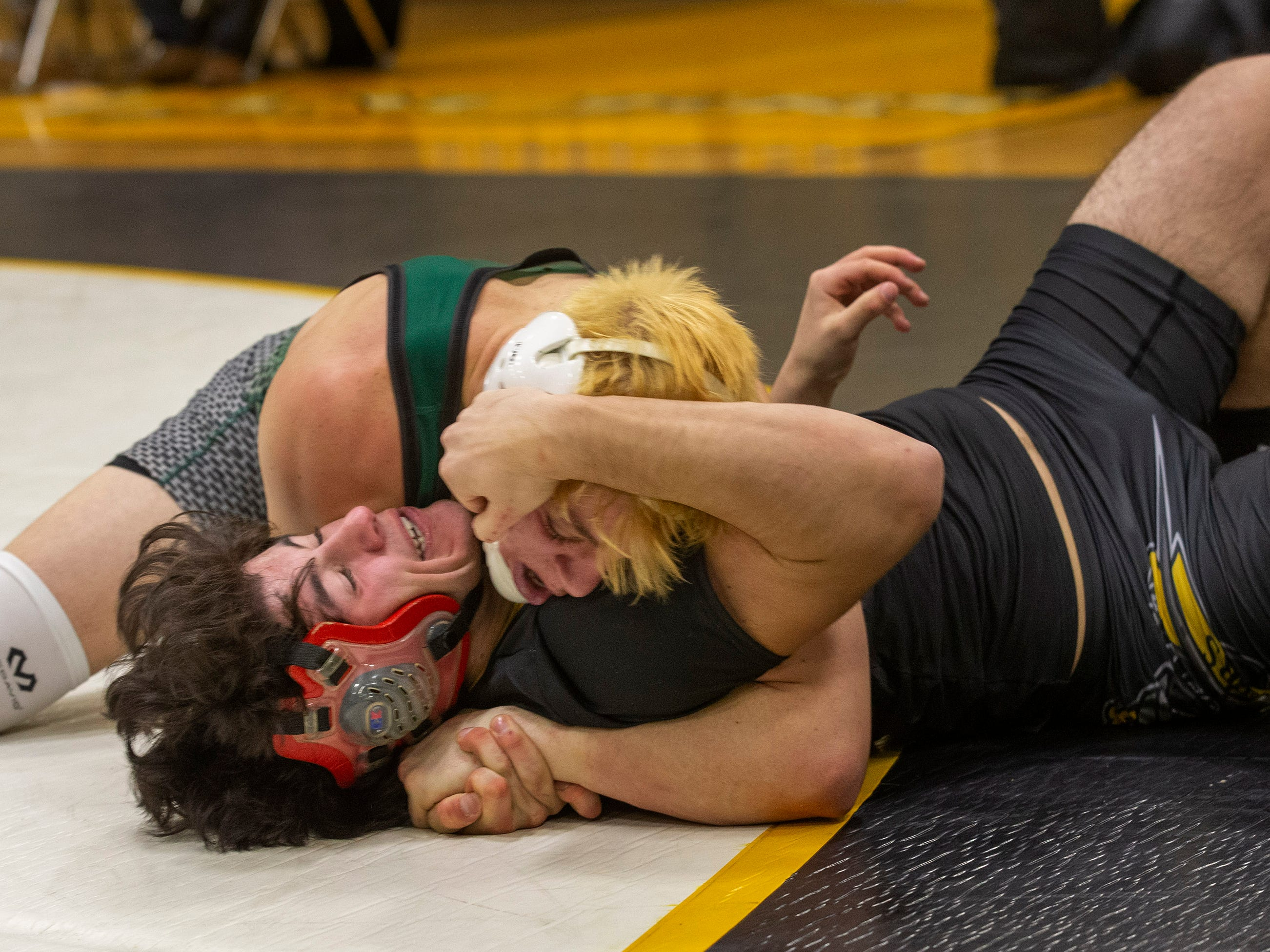 Raritan's Anthony Bailey pins St. John's Nick Caruti in their 160 lbs. bout. Raritan Wrestling defeats St John Vianney in Holmdel, NJ on January 23, 2019.