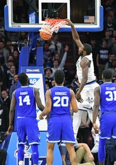 Villanova Wildcats forward Eric Paschall (4) slam dunks against the Seton Hall Pirates during the second half at Wells Fargo Center in 2018.