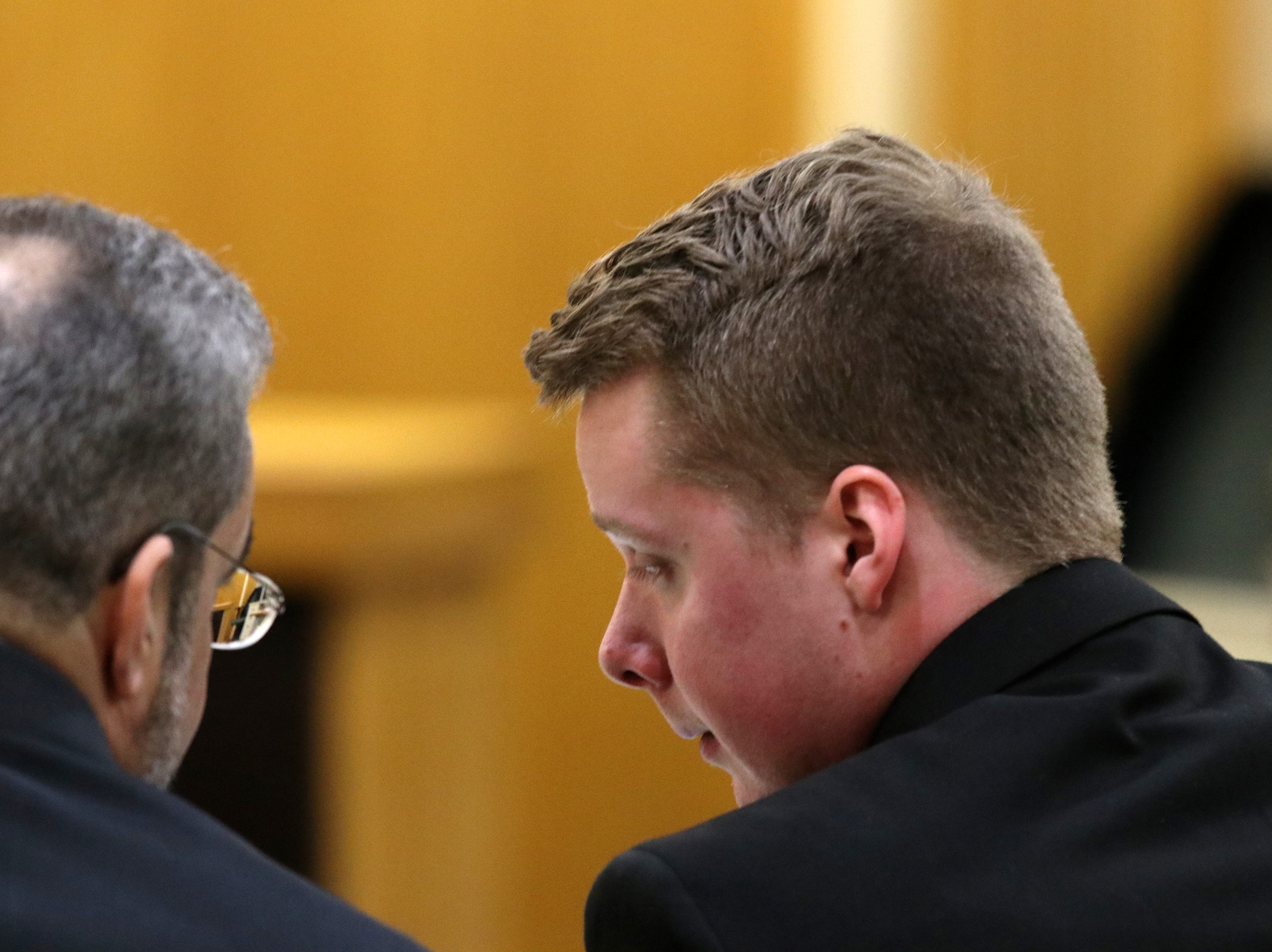 A teary-eyed Liam McAtasney, who is charged with the murder of former high school classmate, Sarah Stern, talks to his lawyer after former Brennen's Steakhouse co-worker Laura Carmody testifies during the second day of trial before Superior Court Judge Richard W. English at the Monmouth County Courthouse in Freehold, NJ Thursday January 24, 2019.