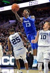 Seton Hall Pirates guard Myles Powell (13) is called for an offensive foul against Villanova Wildcats guard Mikal Bridges (25) during the second half at Wells Fargo Center in 2018.