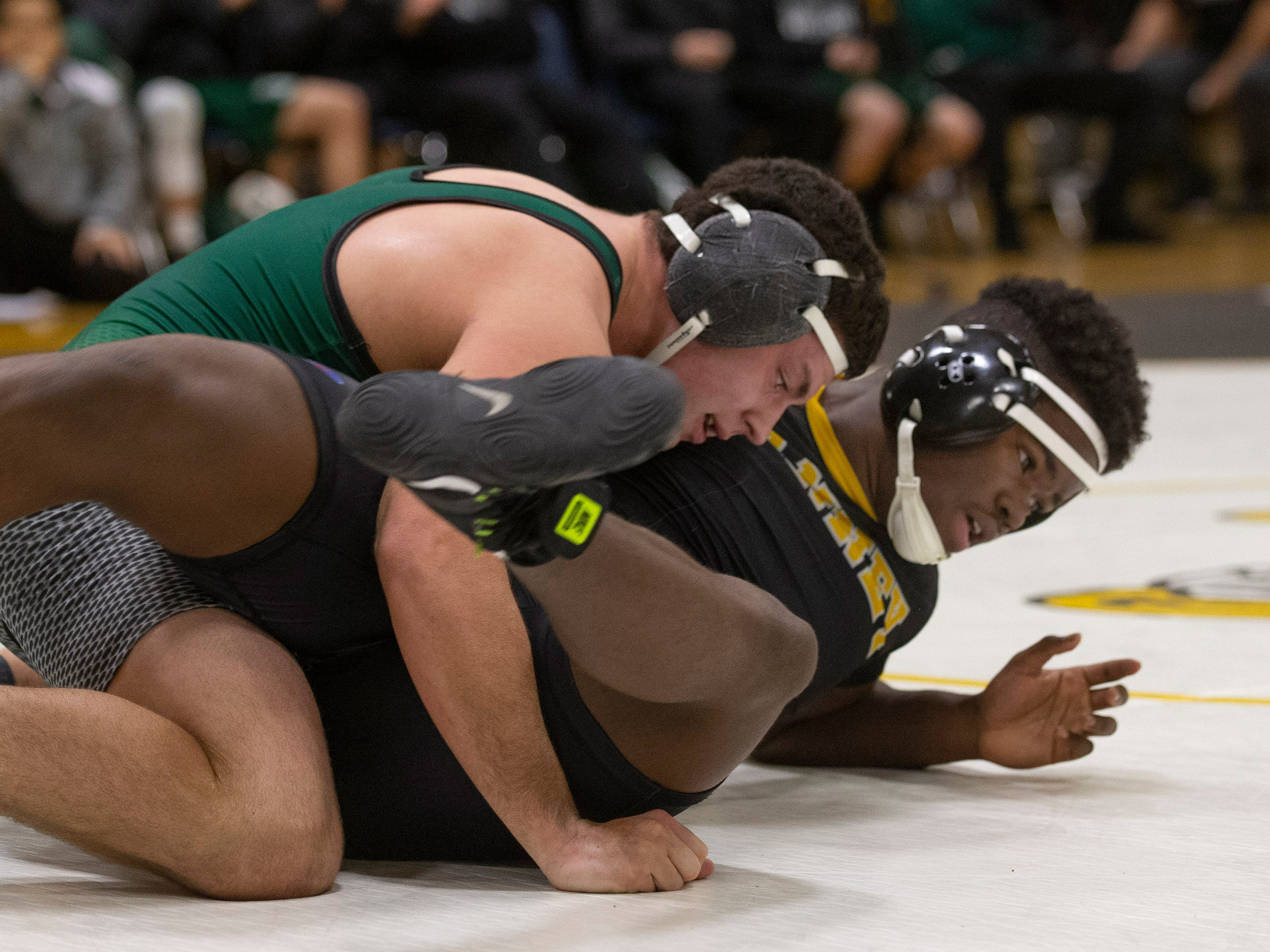 Raritan's Justin Acevedo pins St.John's Jaden Duncan in their 220 lbs bout. Raritan Wrestling defeats St John Vianney in Holmdel, NJ on January 23, 2019.