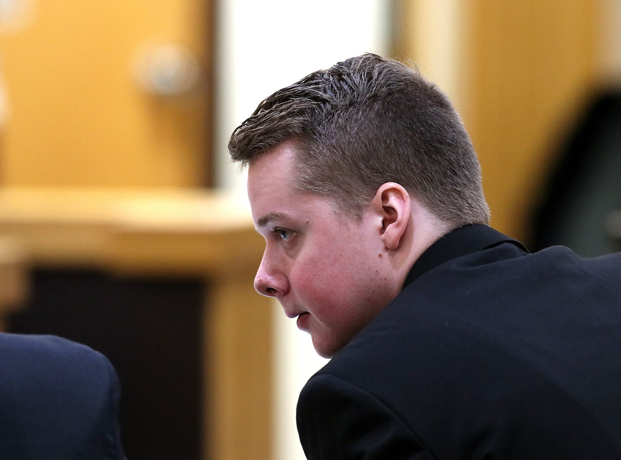 Liam McAtasney, who is charged with the murder of former high school classmate, Sarah Stern, speaks to his lawyer, Carlos Diaz-Cobo, during the second day of trial before Superior Court Judge Richard W. English at the Monmouth County Courthouse in Freehold, NJ Thursday January 24, 2019.