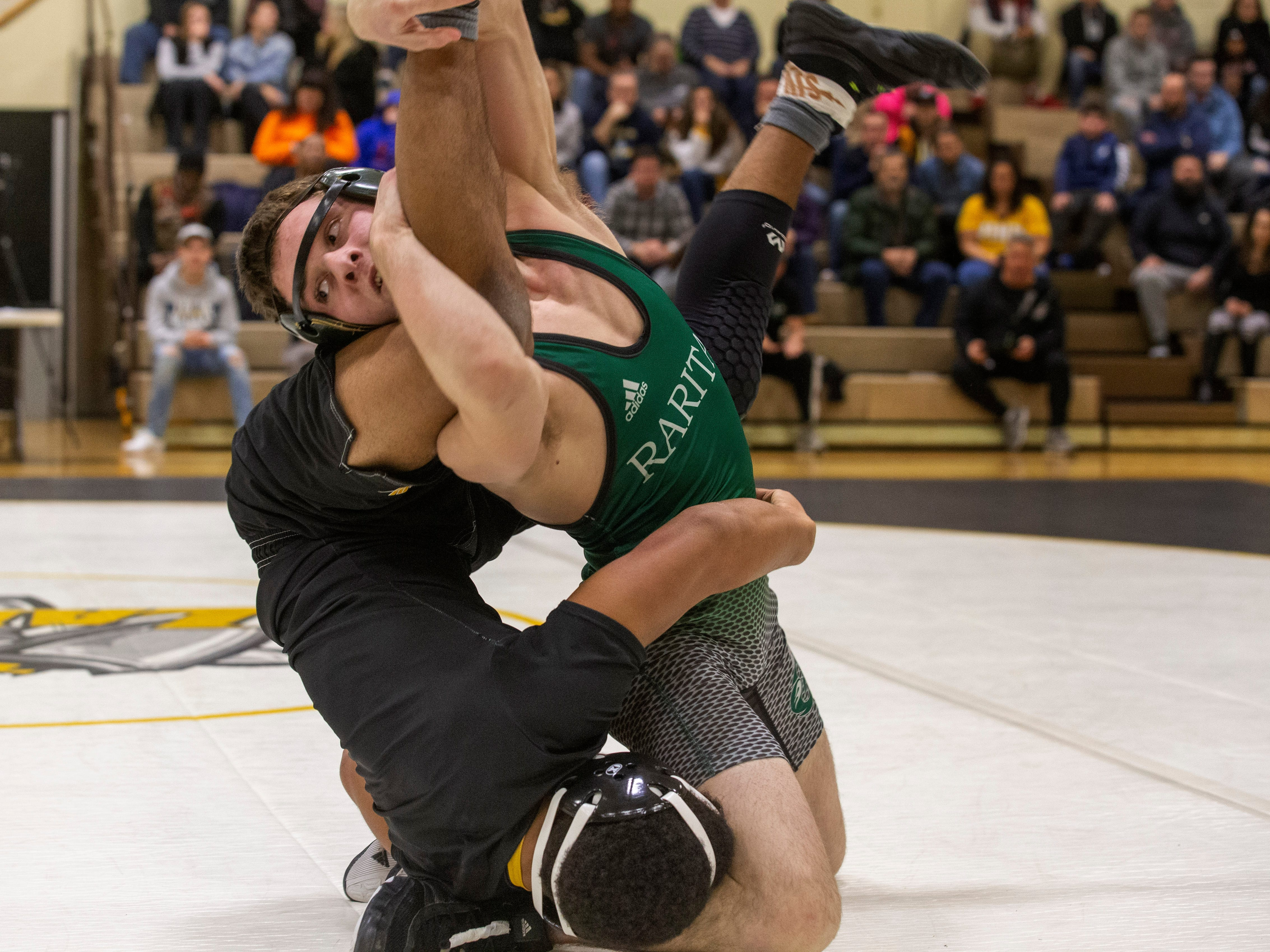 Raritan's Cameron Rafalko defeats St. John's Gabe Jones in their 138 lbs. bout. Raritan Wrestling defeats St John Vianney in Holmdel, NJ on January 23, 2019.