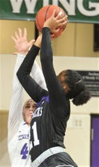 Stephen F. Austin's Aiyana Johnson shoots over ACU's Lexie Ducat in the low post. SFA beat the Wildcats 71-55 in the Southland Conference women's basketball game Wednesday, Jan. 23, 2019, at Moody Coliseum.