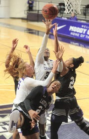 ACU's Maykala Mabry, center, puts up a shot while Stephen F. Austin's Alyssa Mayfield, right, and Aiyana Johnson defends as ACU's Lexi Kirgan (25) helps out. SFA beat the Wildcats 71-55 in the Southland Conference women's basketball game Wednesday, Jan. 23, 2019, at Moody Coliseum.
