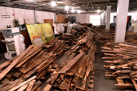 Wood planks are stacked on pallets in the newsroom of the Abilene Reporter-News Wednesday Jan. 23, 2019. The wood was removed from farther back in the building by crews restoring the newspaper after the fire last year. A utility room on the roof of the AR-N caught fire Nov. 15, 2018, shutting down the 138-year-old newspaper and forcing staff to temporarily relocate.