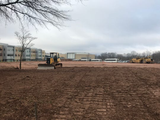 Construction is underway on a new softball field at Asheville Middle School south of downtown.