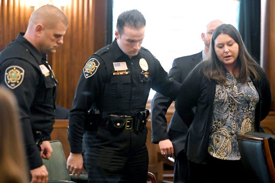 Robin Richardson is led taken from the courtroom after a verdict was reached in the trial against her for the murder of Timothy Fry at the Buncombe County Courthouse on Jan. 24, 2019. Richardson was found guilty of voluntary manslaughter.
