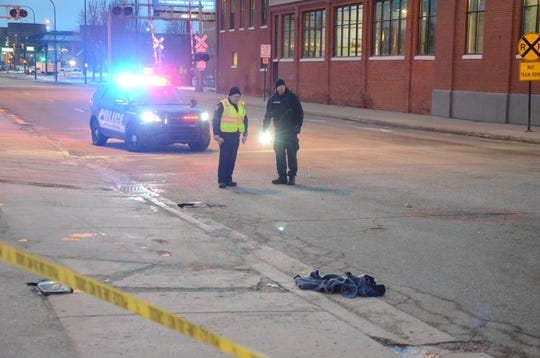 Battle Creek police said a man was struck by a car as he crossed Capital Avenue Southwest Thursday morning.