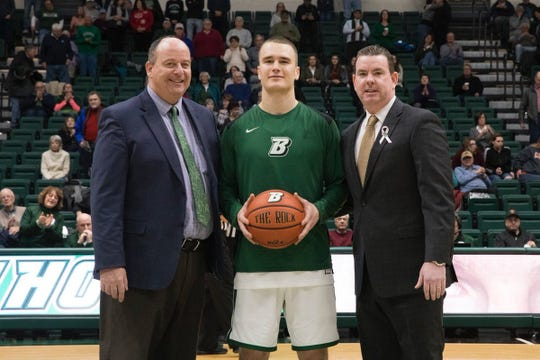 BU's J.C. Show, with AD Pat Elliott (left) and coach Tommy Dempsey (right), saluted for scoring 1,000th point.