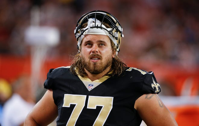 North Mason graduate John Fullington is retiring from the NFL in order to begin his coaching career as an assistant football coach at North Mason High School.