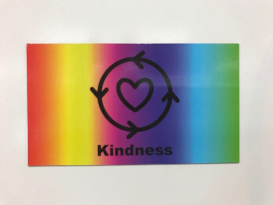 Eighteen T-K students at Tropical Elementary School are pushing to see everyone from local governments to the U.S. Congress adopt a national kindness symbol they helped design. This picture shows the symbol on a magnet the school has been selling.