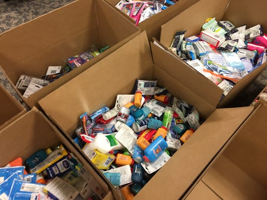 Wednesday afternoon, FLORIDA TODAY employees sorted 20-plus boxes of supplies donated for Operation Gratitude.