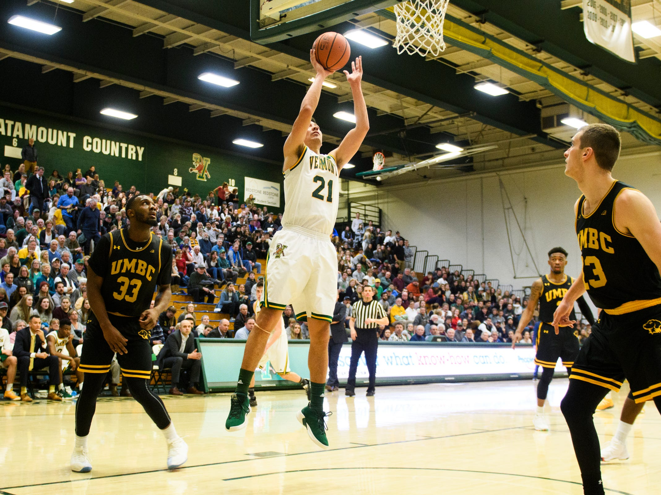 Vermont guard Everett Duncan (21) leaps for a lay up during the men's basketball game between the UMBC Retrievers and the Vermont Catamounts at Patrick Gym on Wednesday night January 23, 2019 in Burlington, Vermont.