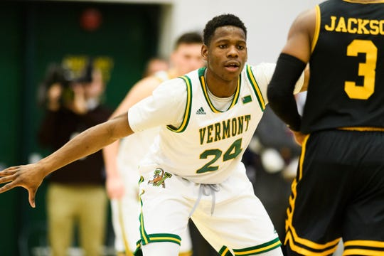 Vermont guard Ben Shungu (24) guards UMBC's K.J. Jackson (3) during the men's basketball game between the UMBC Retrievers and the Vermont Catamounts at Patrick Gym on Wednesday night January 23, 2019 in Burlington, Vermont.