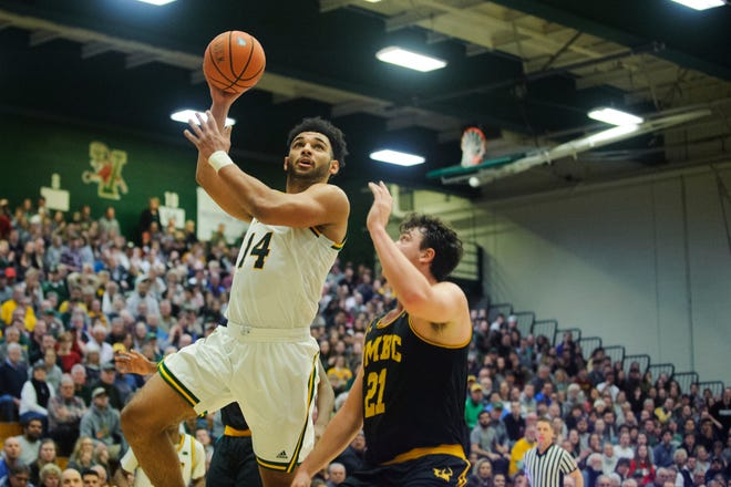 Vermont forward Isaiah Powell (14) leaps to take a shot over UMBC's Sam Schwietz (21) during the men's basketball game between the UMBC Retrievers and the Vermont Catamounts at Patrick Gym on Wednesday night January 23, 2019 in Burlington, Vermont.