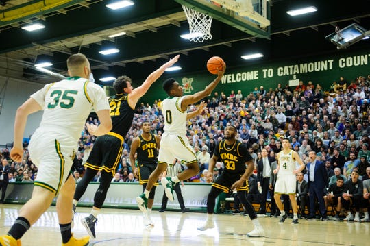 Vermont guard Stef Smith (0) leaps for a lay up during the men's basketball game between the UMBC Retrievers and the Vermont Catamounts at Patrick Gym on Wednesday night January 23, 2019 in Burlington, Vermont.