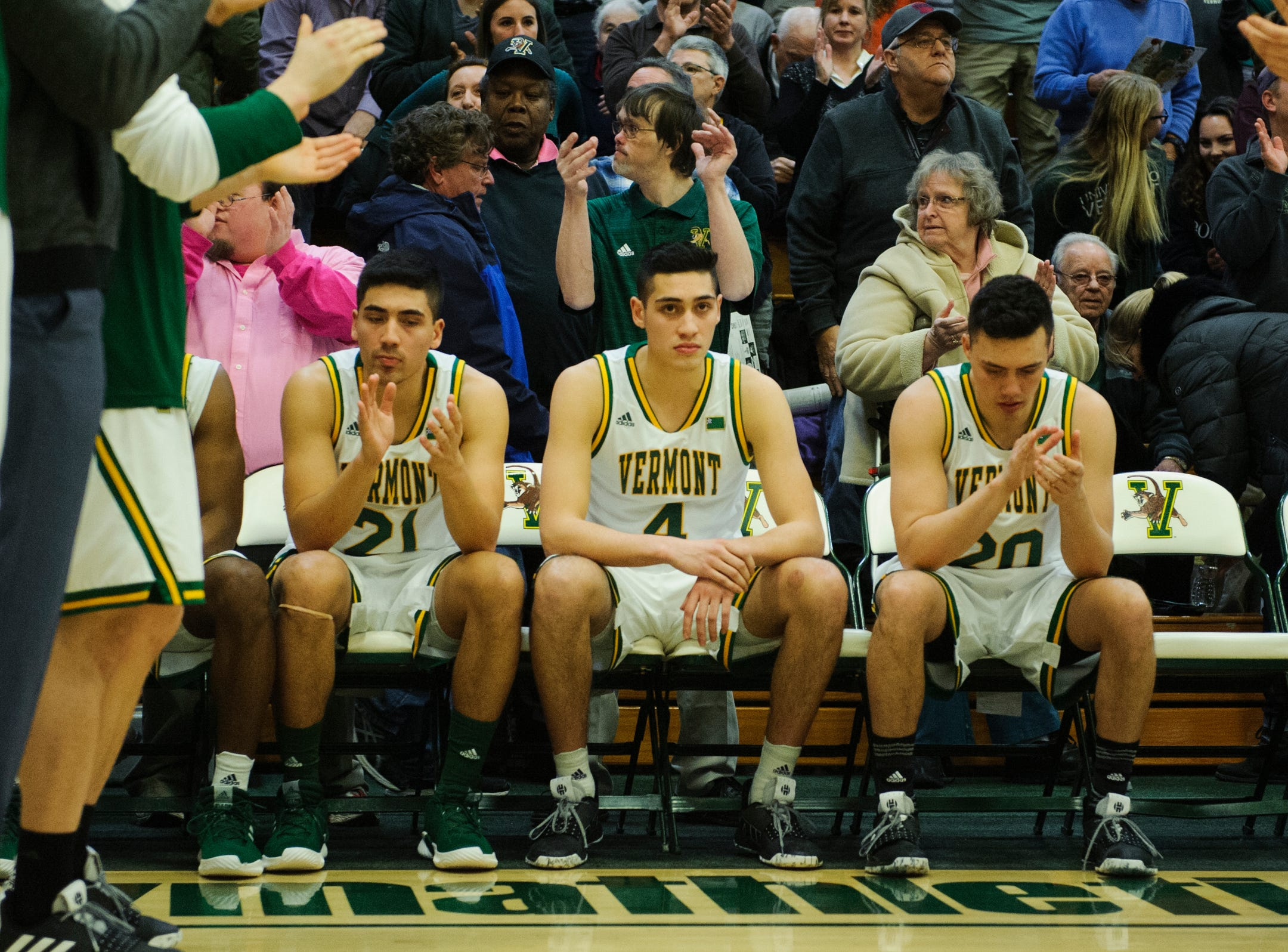 Vermont guard Everett Duncan (21), Vermont guard Robin Duncan (4) and Vermont guard Ernie Duncan (20) wait for the attracting line up announcements during the men's basketball game between the UMBC Retrievers and the Vermont Catamounts at Patrick Gym on Wednesday night January 23, 2019 in Burlington, Vermont. It only the second time in the history of college basketball that three brothers started in the same game.